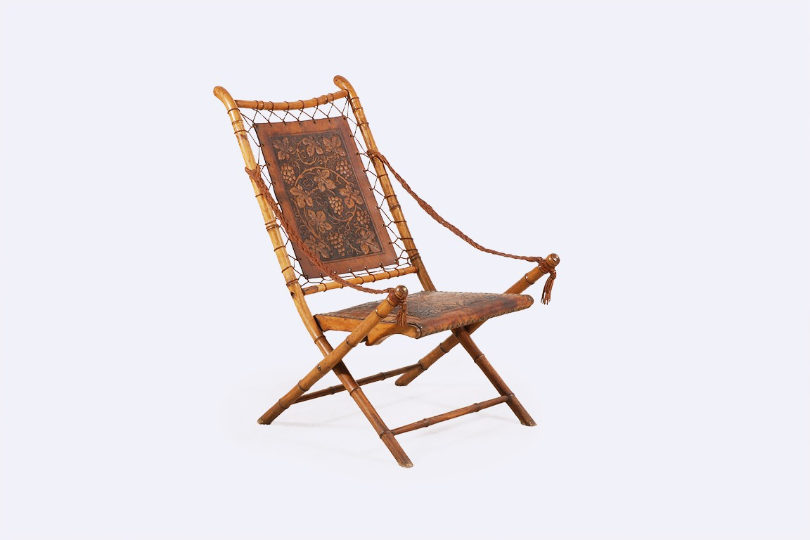 fauteuil pliable france cuir gravé faux bamboo campagne 1900